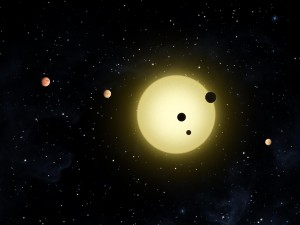 Three planets in the Kepler-11 system as they simultaneously transit their star as imagined by by a NASA artist (Image credit: NASA). From http://ciera.northwestern.edu/Research/highlights/research_highlights.php#ForeignWorlds.