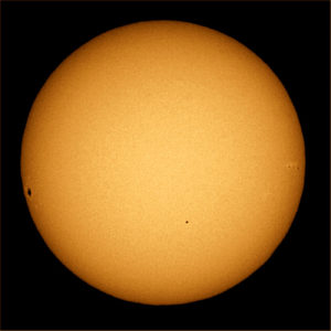 A snapshot of the November 2006 transit of Mercury. The rocky planet appears as a clean-edged disc in the lower hemisphere of the sun. Clusters of sunspots can also be seen near the right and left edges of the sun. From http://www.space.com/32758-mercury-transit-sun-2016-rare-event-may9.html.